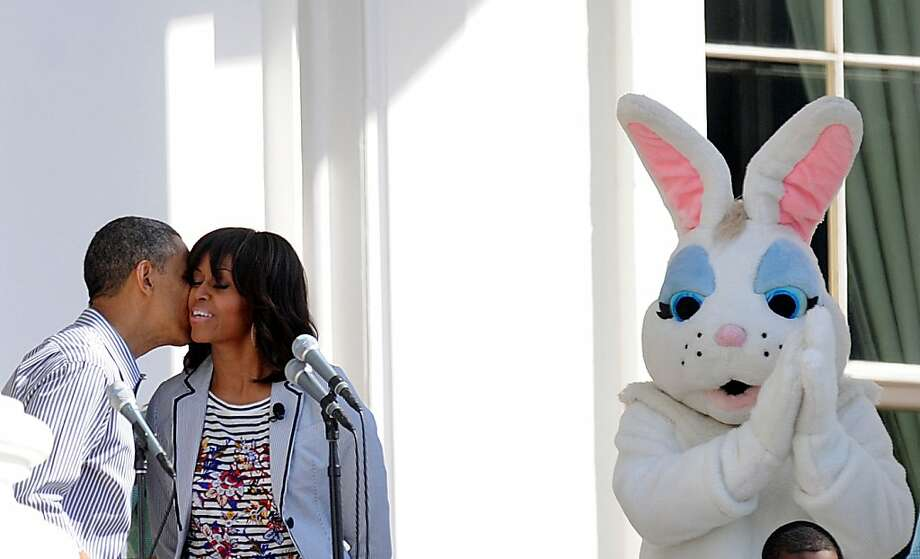 U.S. President Barack Obama kisses first lady Michelle Obama as the Easter Bunny looks on during the White House Easter Egg Roll on the South Lawn of the White House April 1, 2013.  Photo: Olivier Douliery, McClatchy-Tribune News Service