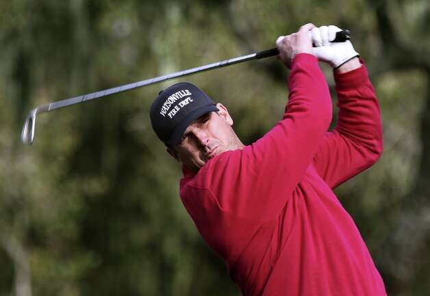 San Francisco 49ers head coach jIm Harbaugh hits his tee shot to the par-3 third hole at the Monterey Peninsula Country Club, during the first round of play at the 2013 Pebble Beach National Pro-Am golf tournament on Thursday Feb. 7, 2013, in Pebble Beach, Ca. Photo: Michael Macor, The Chronicle / ONLINE_YES
