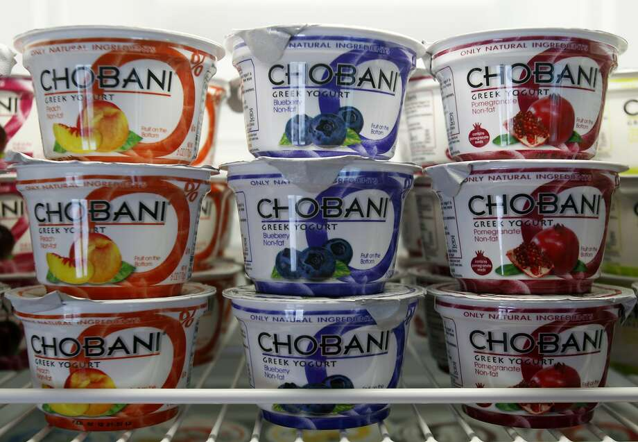 FILE - In this Jan. 13, 2012 photo, Chobani Greek Yogurt is seen at the Chobani plant in South Edmeston, N.Y. The recent yogurt boom of upstate New York has meant more jobs and more economic activity. But it has not led to a bigger dairy herd in the state, even as mega-producer Chobani reaches beyond New York for some of its milk. (AP Photo/Mike Groll, File) Photo: Mike Groll, Associated Press