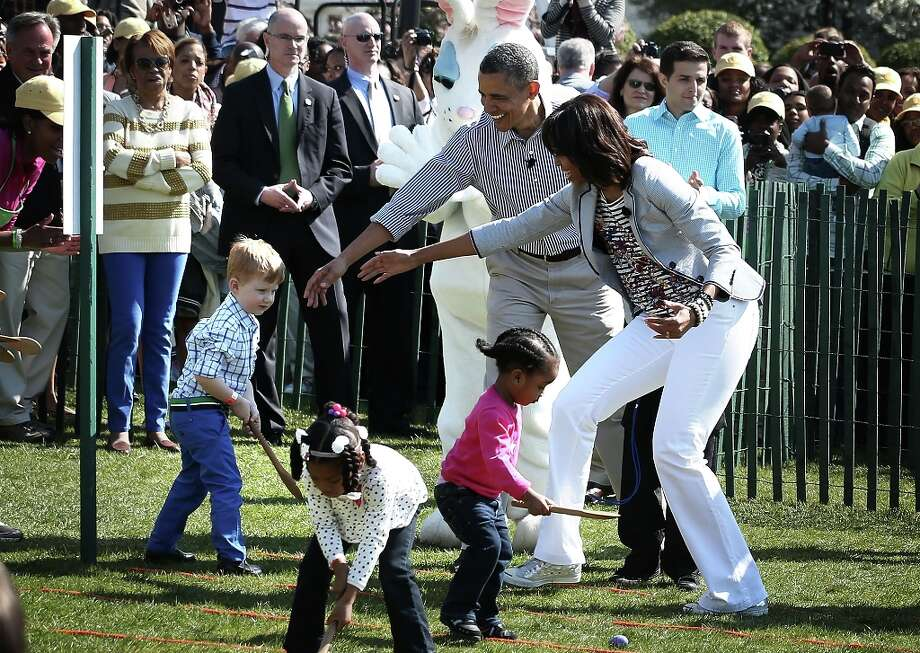 WASHINGTON, DC - APRIL 01:  U.S. President Barack Obama (2nd R) and first lady Michelle Obama (R) watch as children participate during the annual White House Easter Egg Roll on the South Lawn of the White House April 1, 2013 in Washington, DC.  President Obama and first lady Michelle Obama hosted thousands of people during the annual celebration of Easter. Photo: Alex Wong, Getty Images / 2013 Getty Images