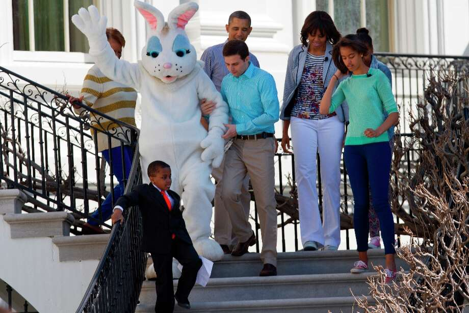 Robby Novak, known as Kid President, followed by President Barack Obama and his family, first lady Michelle Obama, daughters Malia and Sasha, his mother-in-law Marian Robinson, and an unidentified man helping the Eastern Bunny, walks down the stairs of the White House in Washington, Monday, April 1, 2013, to the South Lawn and the annual White House Easter Egg Roll.  (AP Photo/Jacquelyn Martin) Photo: Jacquelyn Martin, Associated Press / AP