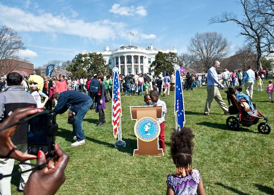 Children have their picture taken at a mock presidential rostrum during the annual White House Easter Egg Roll in Washington on April 1, 2013.   AFP PHOTO/Nicholas KAMMNICHOLAS KAMM/AFP/Getty Images Photo: NICHOLAS KAMM, AFP/Getty Images / AFP