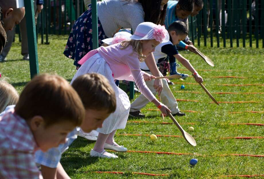 Children roll eggs on the South Lawn during the annual White House Easter Egg Roll in Washington on April 1, 2013.   AFP PHOTO/Nicholas KAMMNICHOLAS KAMM/AFP/Getty Images Photo: NICHOLAS KAMM, AFP/Getty Images / AFP