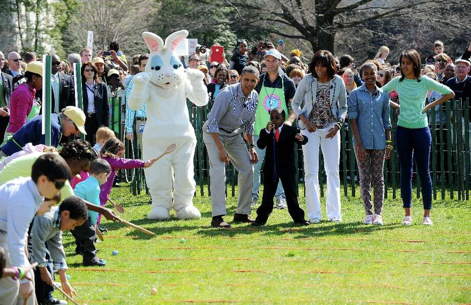 U.S President Barack Obama, First Lady Michelle Obama and daughters Malia and Sasha watch participants roll eggs during the White House Easter Egg Roll on the South Lawn of the White House April 1, 2013. (Olivier Douliery/Abaca Press/MCT) Photo: Olivier Douliery, McClatchy-Tribune News Service / Abaca Press