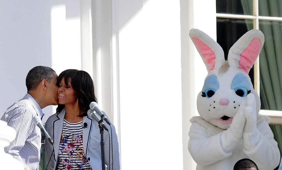 U.S. President Barack Obama kisses first lady Michelle Obama as the Easter Bunny looks on during the White House Easter Egg Roll on the South Lawn of the White House April 1, 2013. (Olivier Douliery/Abaca Press/MCT) Photo: Olivier Douliery, McClatchy-Tribune News Service / Abaca Press