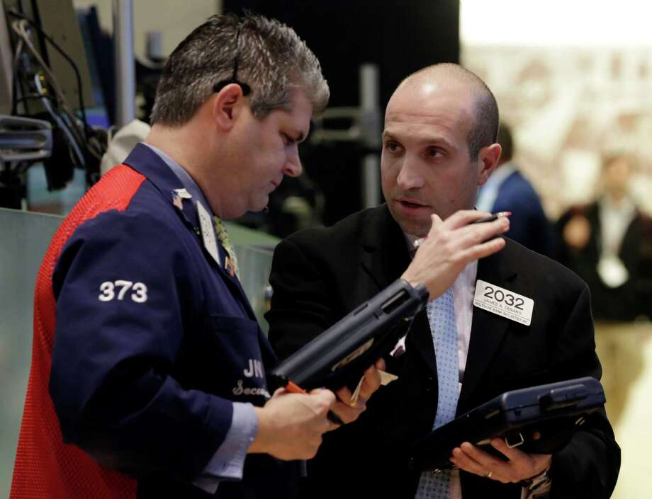 FILE - In this Thursday, March 28, 2013, file photo, Trader John Panin, left, and James Denaro consult on the floor of the New York Stock Exchange Thursday, March 28, 2013. Stocks edged lower on Wall Street Monday morning after an industry group reported that U.S. manufacturing growth cooled in March and was weaker than economists had forecast.   (AP Photo/Richard Drew) Photo: Richard Drew