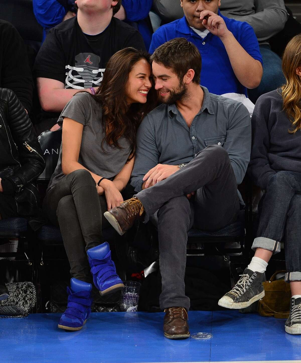 Chace Crawford (R) and cuddles with rumored new girlfriend Rachelle Goulding at the Charlotte Bobcats vs New York Knicks game at Madison Square Garden on March 29, 2013 in New York City.