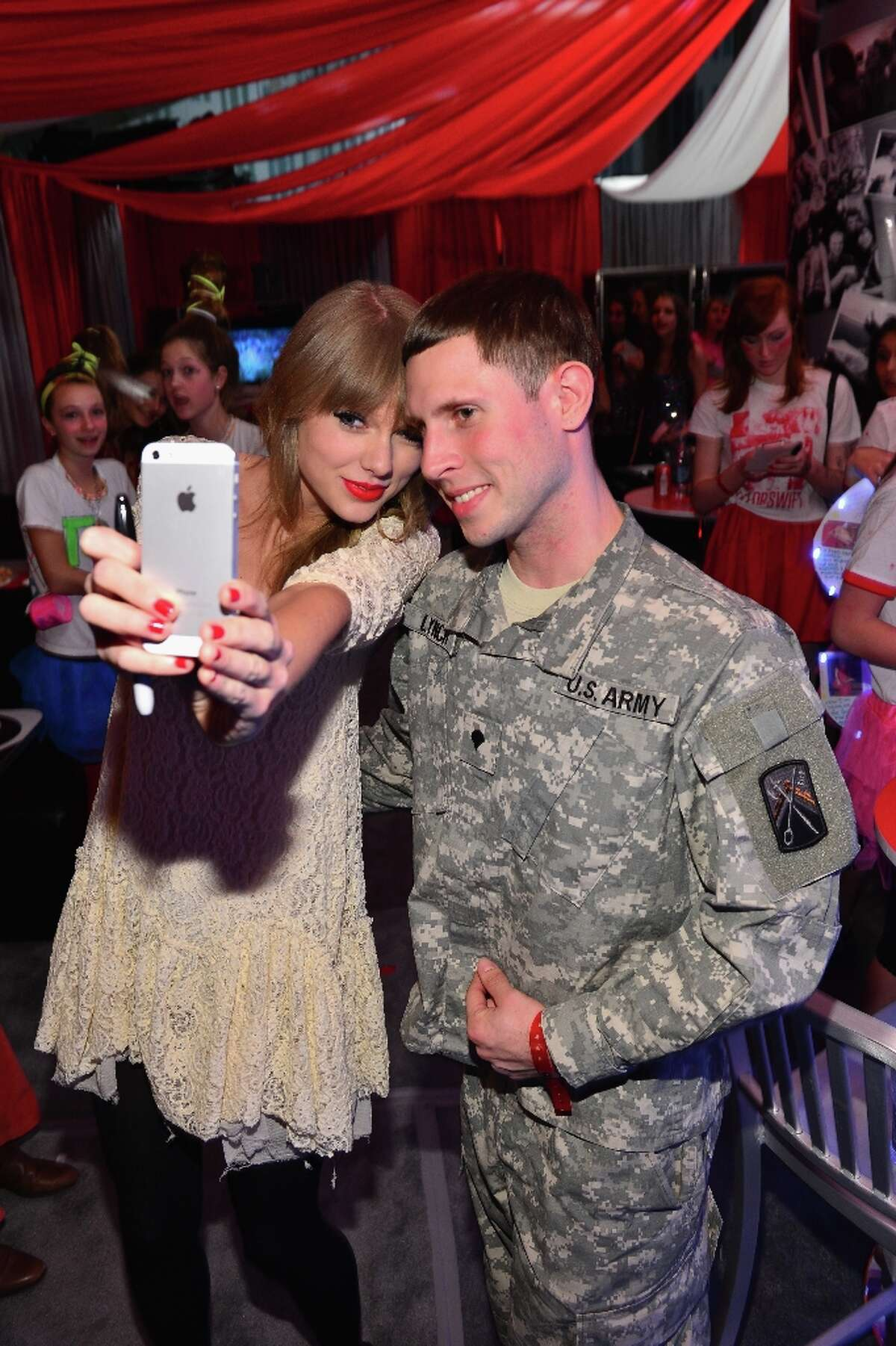 Singer Taylor Swift meets a fan in Club Red after her show at the Prudential Center on March 28, 2013 in Newark, New Jersey.