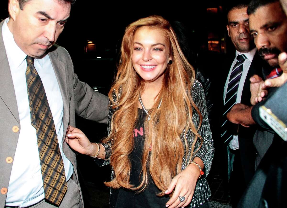 Though she's due to begin court-mandated rehab on May 2, Lindsay Lohan attends the inauguration of the John John store at Oscar Freire Street on March 29, 2013 in Sao Paulo, Brazil.
