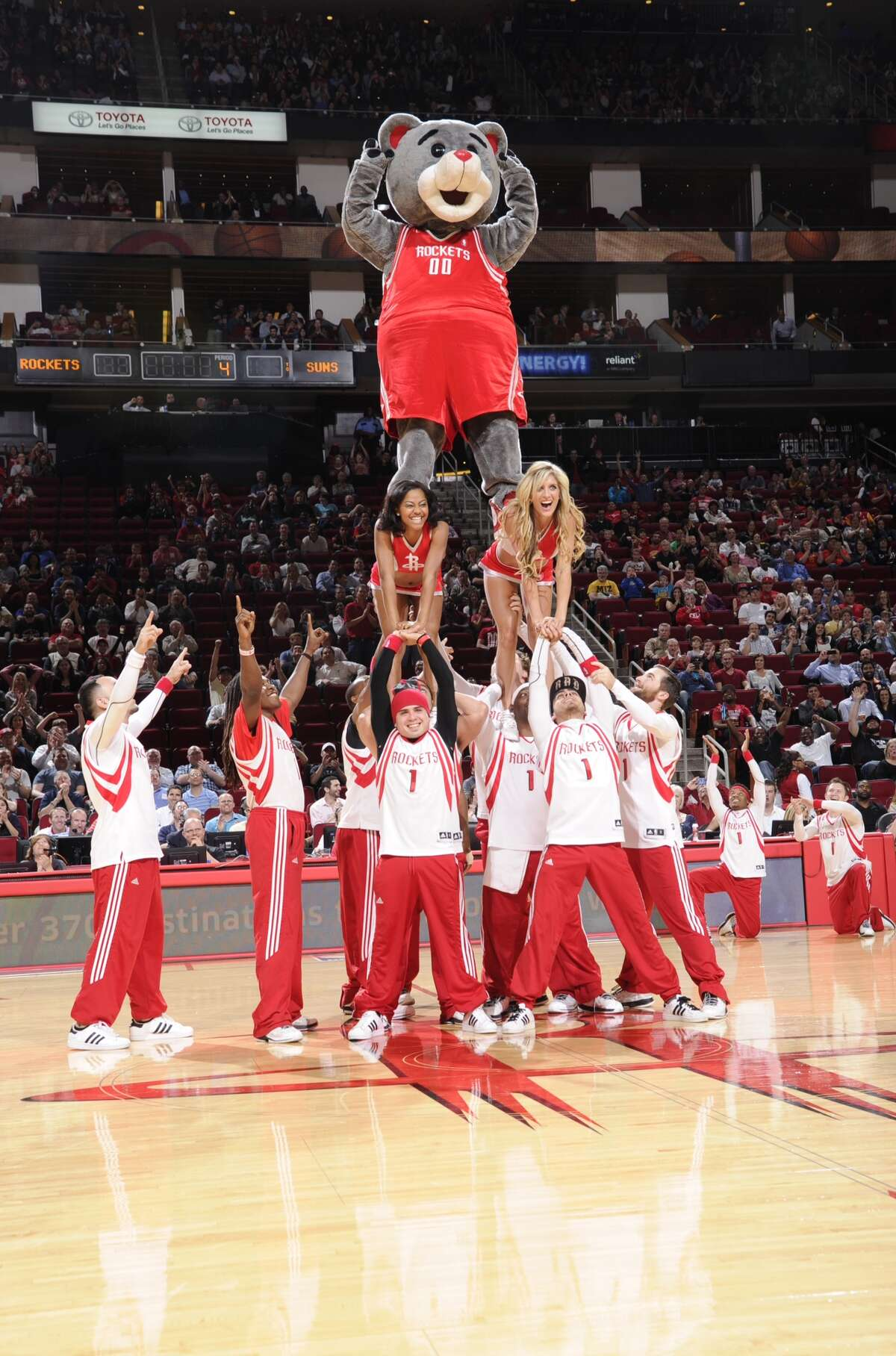 Clutch at the top of the pyramid at a Rockets game. HOUSTON, TX - MARCH 13: The Launch Crew and Clutch Mascot of the Houston Rockets perform during the game against the Phoenix Suns on March 13, 2013 at the Toyota Center in Houston, Texas. NOTE TO USER: User expressly acknowledges and agrees that, by downloading and or using this photograph, User is consenting to the terms and conditions of the Getty Images License Agreement. Mandatory Copyright Notice: Copyright 2013 NBAE (Photo by Bill Baptist/NBAE via Getty Images)