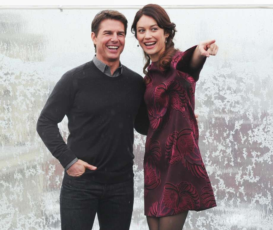 Olga Kurylenko and Tom Cruise attend a photo call of the 'Oblivion' at the Ritz Carlton Hotel on April 1, 2013 in Moscow, Russia. Photo: Epsilon, Getty Images / 2013 Epsilon