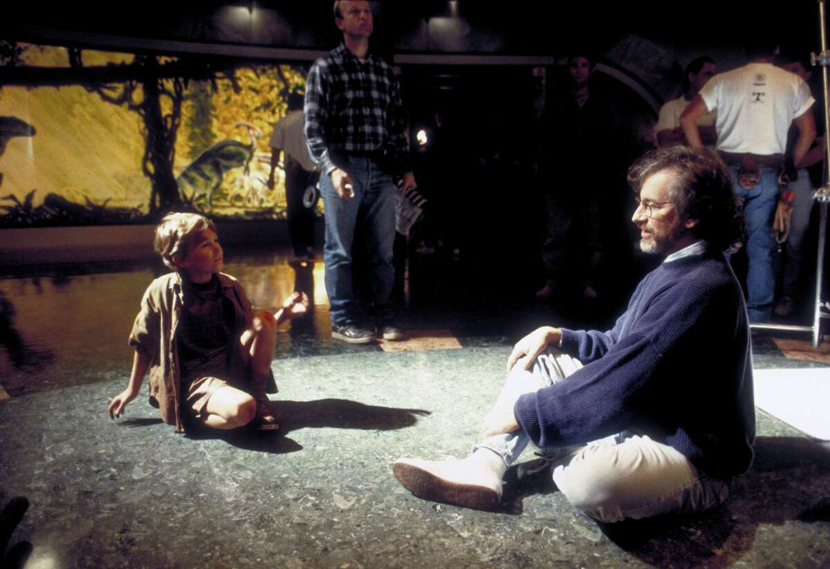 Director Steven Spielberg works with child actor Joseph Mazzello during the filming of 'Jurassic Park,' in 1993.