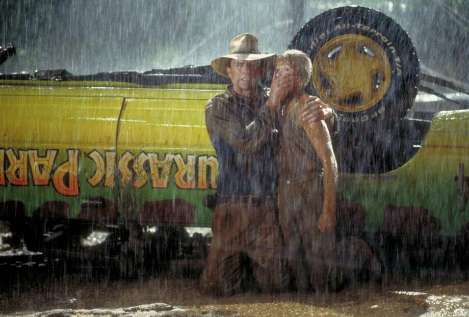 Actor Sam Neill as Dr. Alan Grant and Ariana Richards as Lex try to  avoid the attentions of a Tyrannosaurus Rex in a scene from the film  'Jurassic Park.' Photo: Murray Close, Getty Images / 2011 Murray Close