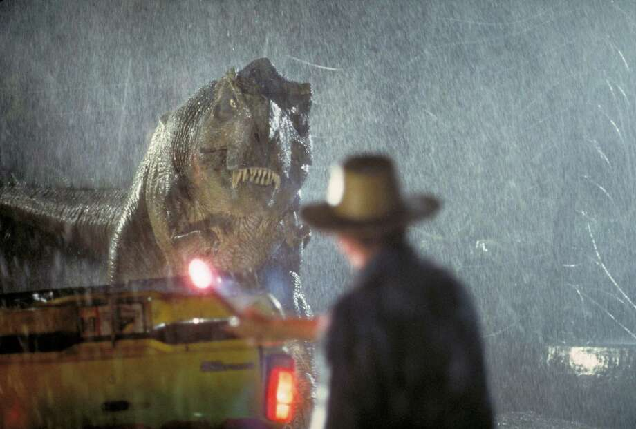 Actor Sam Neill as Dr. Alan Grant takes on a Tyrannosaurus Rex in a scene from the film 'Jurassic Park.' Photo: Murray Close, Getty Images / 2011 Murray Close