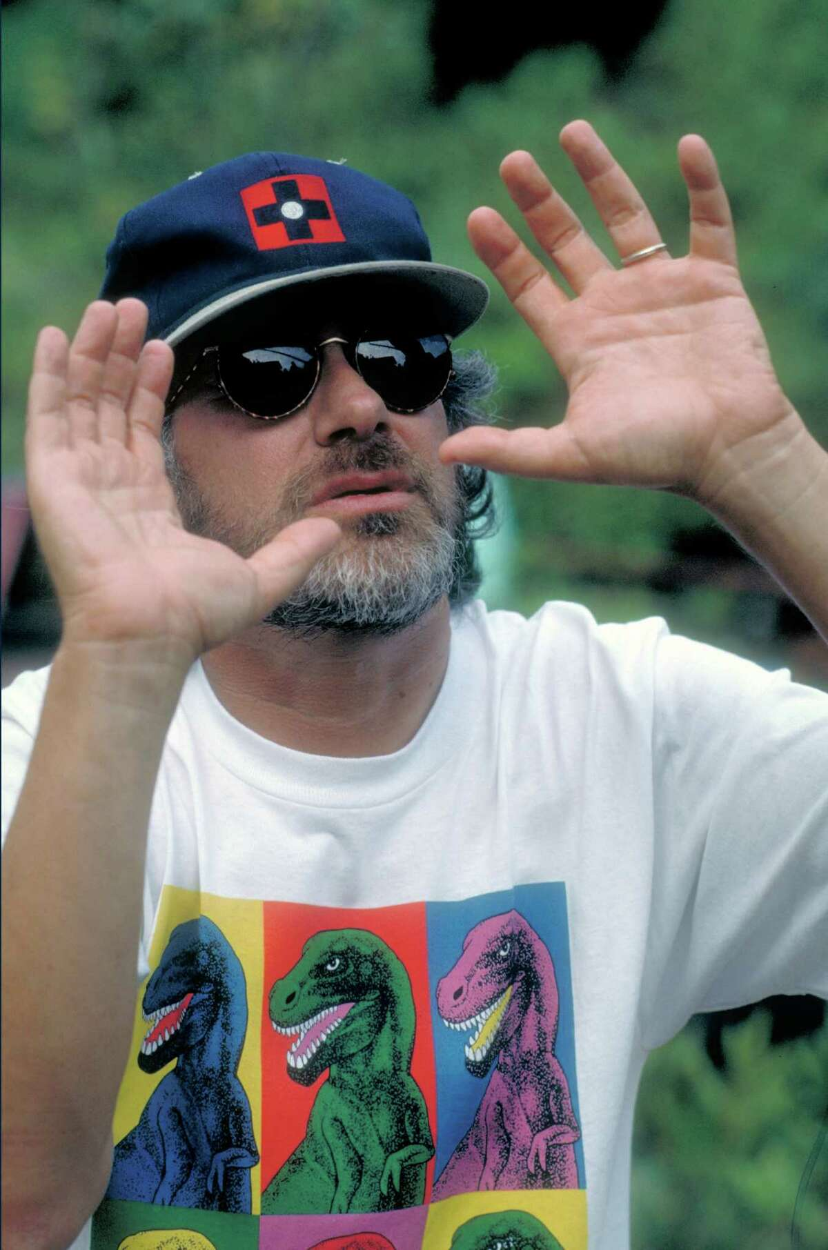 Director Steven Spielberg turned the book into a film. Here, he wears a Warhol-inspired dinosaur t-shirt while directing the movie.