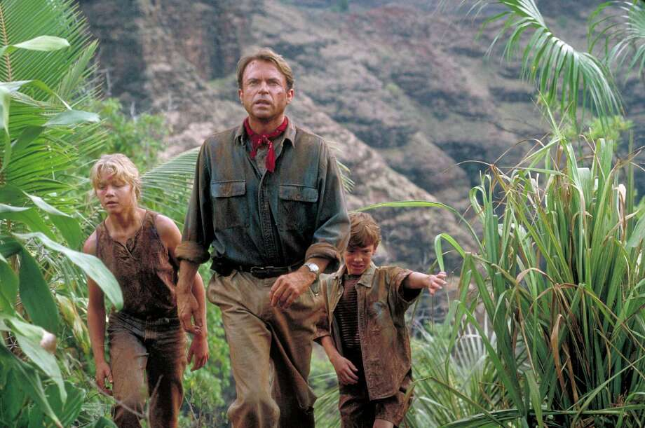 Actor Sam Neill as Dr. Alan Grant, with Ariana Richards (left) and Joseph Mazzello (right) as Lex and Tim, in a scene from the film 'Jurassic Park.' Photo: Murray Close, Getty Images / 2011 Murray Close