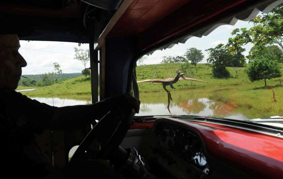 A tourist truck drives through the Jurassic Park the Napoles ranch theme park in Puerto Triunfo, Colombia on June 21, 2009. Photo: AFP/Getty Images