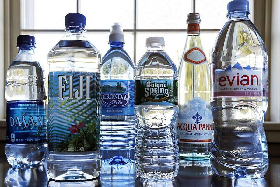 Bottled water's popularity has helped H{-2}0 reclaim its top spot over soda. Photo: Charles Krupa, Associated Press