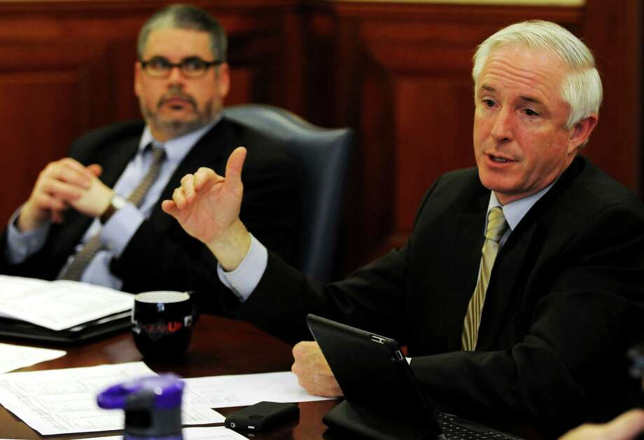 Andrew J. Nunn, Chief Administrative Officer, listens as Bridgeport Mayor Bill Finch presented an overview his proposed city budget to the Connecticut Post on Monday, April 1, 2013. The full budget will be presented to the City Council on Tuesday, April 2, 2013. Photo: Cathy Zuraw / Connecticut Post