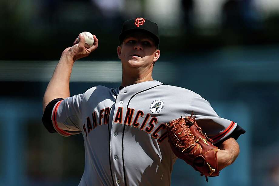 San Francisco Giants starting pitcher Matt Cain throws during the first inning of a season opening baseball game against the Los Angeles Dodgers in Los Angeles, Monday, April 1, 2013. Photo: Jae C. Hong, Associated Press / AP