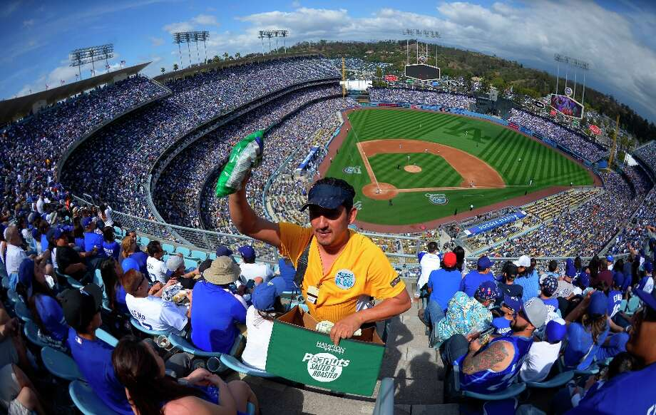 Henry Rivera sells peanuts during the Los Angeles Dodgers' Opening Day baseball game against the San Francisco Giants at Dodger Stadium, Monday, April 1, 2013, in Los Angeles. Photo: Mark J. Terrill, Associated Press / AP