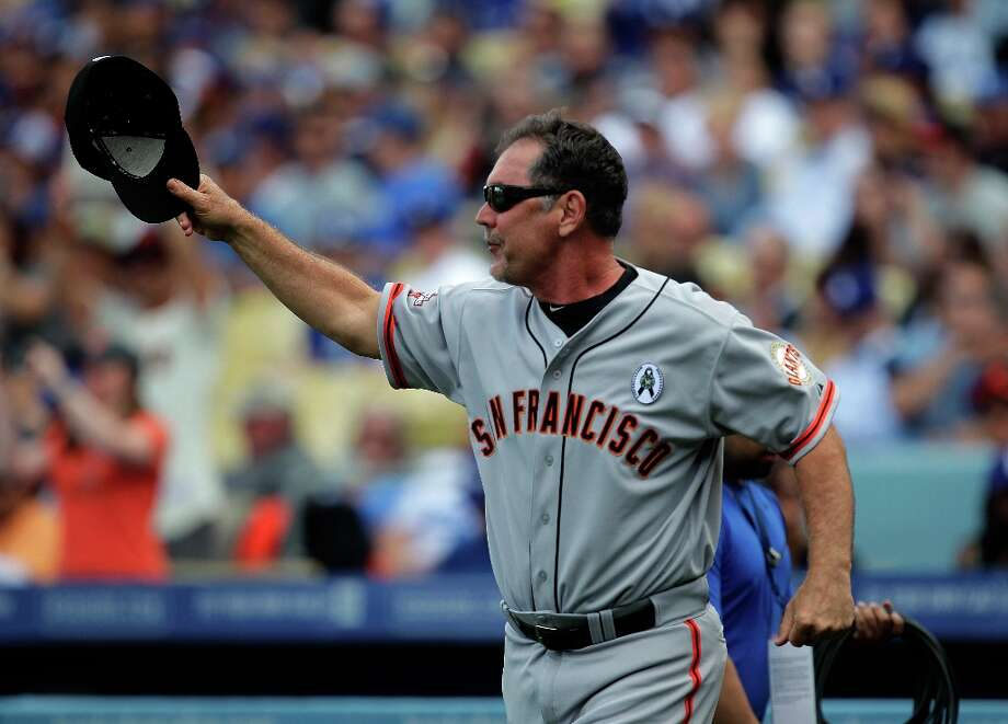 San Francisco Giants manager Bruce Bochy takes his hat off during introductions prior to their opening day baseball game against the Los Angeles Dodgers in Los Angeles, Monday, April 1, 2013. Photo: Jae C. Hong, Associated Press / AP