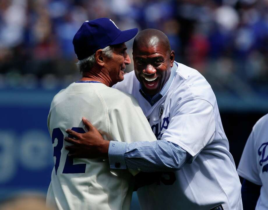 Los Angeles Dodgers owner Magic Johnson, right, hugs former Dodger pitcher Sandy Koufax prior to the Dodger's season-opening baseball game against the San Francisco Giants in Los Angeles, Monday, April 1, 2013. Photo: Jae C. Hong, Associated Press / AP