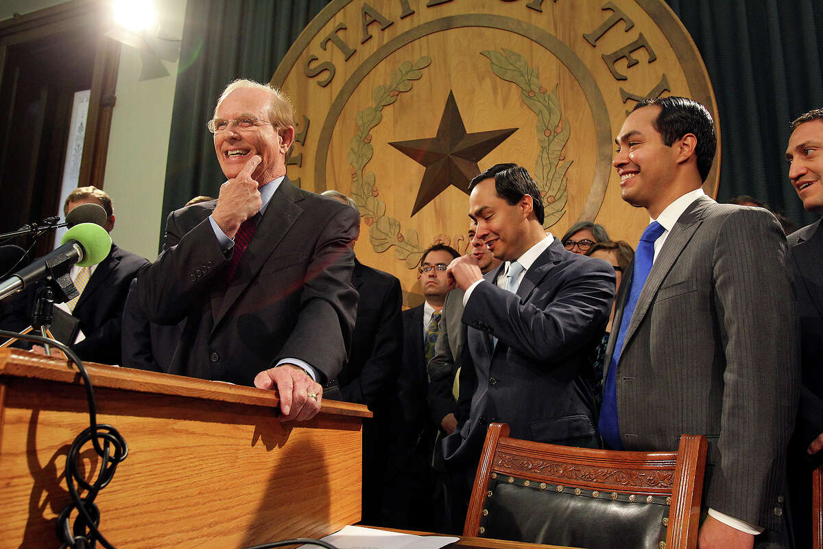 Bexar County Judge Nelson Wolff refers to a recent root canal while talking about Medicaid in Texas during a press conferences at the State Capitol in Austin on April 1, 2013. San Antonio Mayor Julian Castro, U.S. Rep. Joaquin Castro, state representative Trey Martinez-Fischer and other supporters also were in attendance.