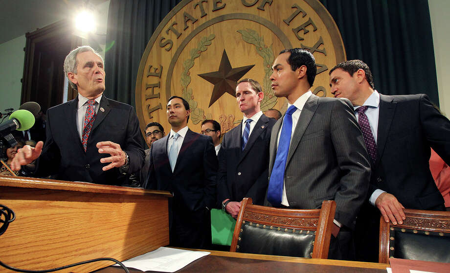 Congressman Lloyd Doggett makes a point with U.S. Rep. Joaquin Castro (center) , San Antonio Mayor Julian Castro and state representative Trey Martinez-Fischer listening during a press conferences at the State Capitol in Austin on  April 1, 2013. Photo: TOM REEL