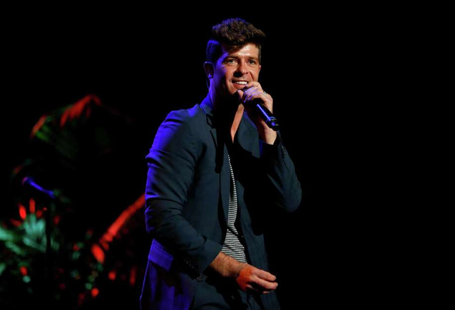"FILE - This Sept. 15, 2012 file photo originally released by Point Foundation shows singer Robin Thicke performing at the ""Voices On Point"" Concert & Gala in Los Angeles. Thicke's, ""Blurred Lines,"" was the most viral track on Spotify from Monday, March 25, to Sunday, March 31.  (AP Photo/Point Foundation, Colin Young-Wolff, file) Photo: Colin Young-Wolff"