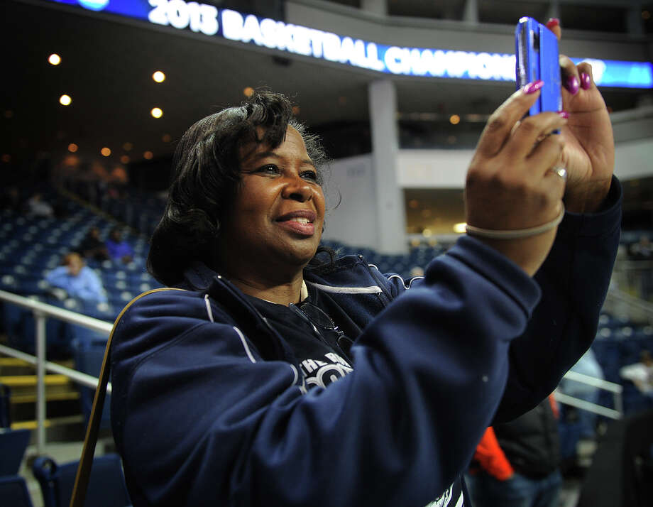 "Self described ""huge fan"" Deborah Benn of Norwalk snaps photos during warmups before UCONN's elite eight women's basketball matchup with Kentucky at the Webster Bank Arena in Bridgeport, Conn. on Monday, April 1, 2013. Photo: Brian A. Pounds / Connecticut Post"