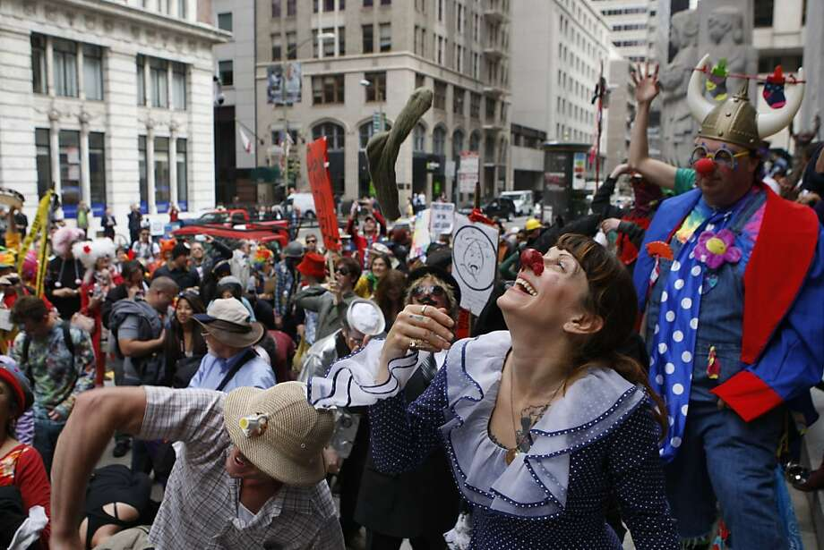 Spy Emerson (front) with her mate Lucky Anderson (left in safari hat) from Oakland throw socks on the steps of the Pacific Stock exchange during the 35th annual St. Stupid's Day parade in San Francisco, California, on Monday, April 1, 2013. Photo: Liz Hafalia, The Chronicle