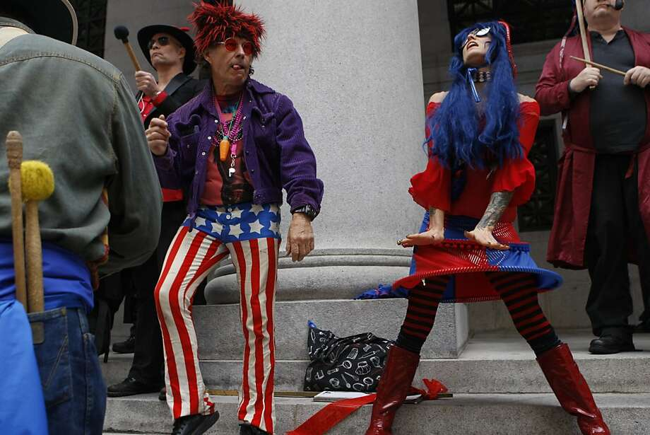 Geoff Walker (left) and Lois C. Denominator (right) both from San Francisco dance at the Pacific Stock exchange during the 35th annual St. Stupid's Day parade in San Francisco, California, on Monday, April 1, 2013. Photo: Liz Hafalia, The Chronicle