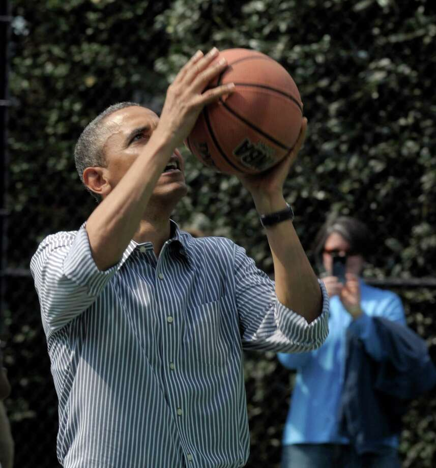 President Barack Obama's pickup basketball prowess makes him the latest in the line of presidents with athletic backgrounds. He played on a state championship team during his high school years in Hawaii. Photo: Susan Walsh