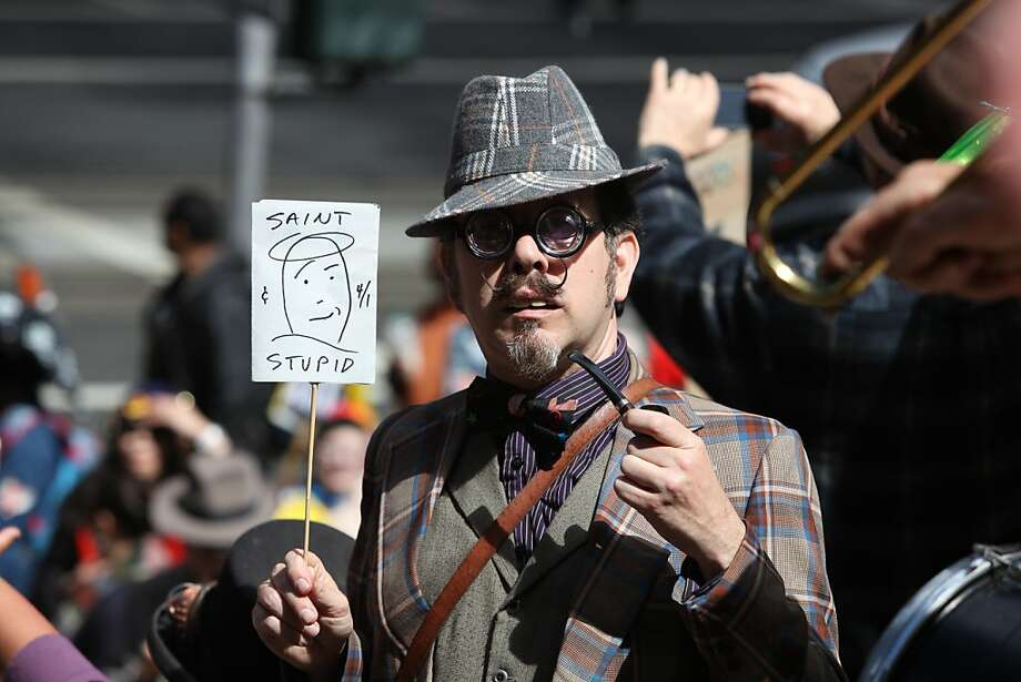 Professor Violet from San Francisco holds his sign during the 35th annual St. Stupid's Day parade in front of 100 California St. in San Francisco, California, on Monday, April 1, 2013. Photo: Liz Hafalia, The Chronicle