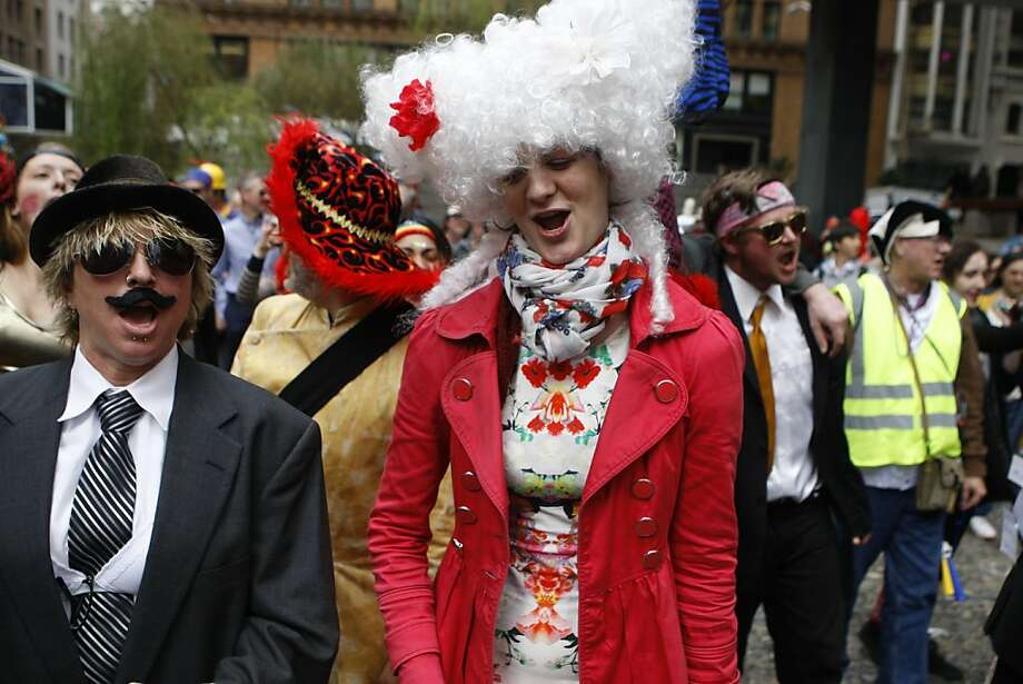 Ty McKenzie (left) and Teri Angst (middle), both from San Francisco, chant in a plaza on Sansome at Sutter streets  during the 35th annual St. Stupid's Day parade in San Francisco, California, on Monday, April 1, 2013. Photo: Liz Hafalia, The Chronicle