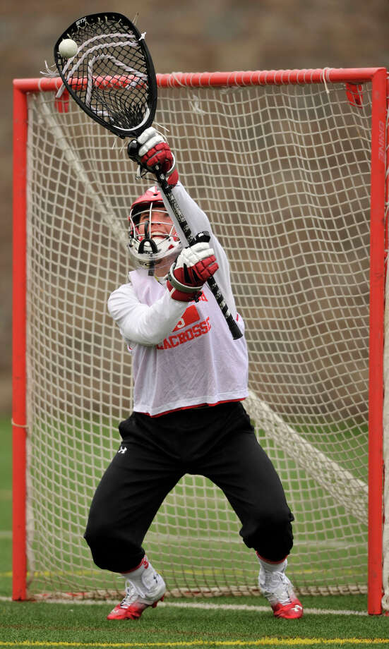 Goalie and co-captain Will Waesche runs drills during lacrosse practice at Greenwich High School on Monday, April 1, 2013. Photo: Jason Rearick / The (Stamford) Advocate