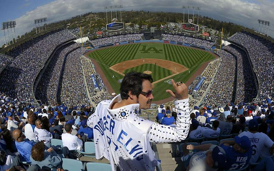 "Danny Del Toro, also know as ""Dodger Elvis,"" revs up the fans during the Los Angeles Dodgers' Opening Day baseball game against the San Francisco Giants at Dodger Stadium, Monday, April 1, 2013, in Los Angeles.  Photo: Mark J. Terrill, Associated Press"