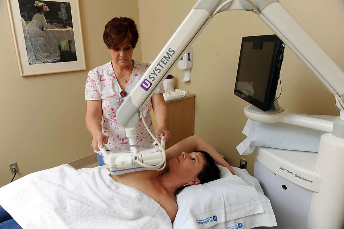 Marta Bright undergoes an Automated Breast Ultrasound Device (ABUS) study given by Audrey Pitcher to supplement her screening mammogram at El Camino Hospital on March 29, 2013. This study can be used as an adjunct study in women with dense breasts.