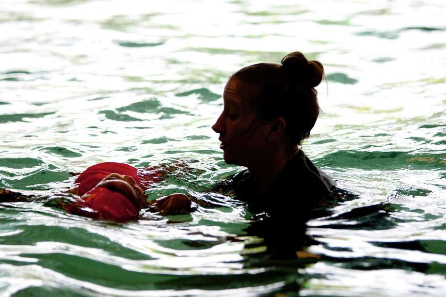 Swim instructor Andrea Smith works with 2-year-old Aubrey Yanez, at the Houston Swim Club in Sharpstown after a press conference for April Pools Day about pool safety Monday, April 1, 2013, in Houston. 