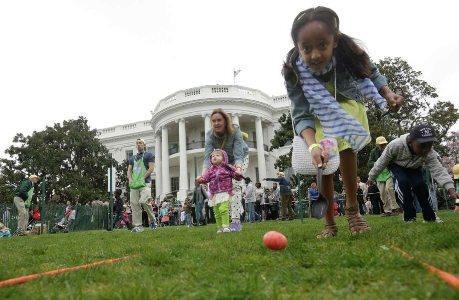 "Following in the White house tradition, the Pequot Library will hold an ""egg roll"" on the lawn Saturday. Bring your own hard-boiled eggs for decorating first and a long-handled wooden spoon. Dance the Bunny Hop and meet the Easter Bunny himself. Find out more.  Photo: Pablo Martinez Monsivais, Associated Press / AP"