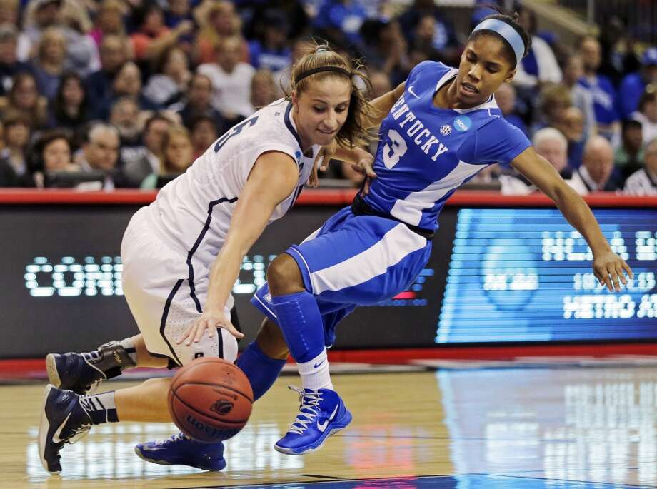 Connecticut guard Caroline Doty, left, collides with Kentucky guard Janee Thompson, right, in the first half of a women's NCAA regional final basketball game in Bridgeport, Conn., Monday, April 1, 2013. (AP Photo/Charles Krupa)