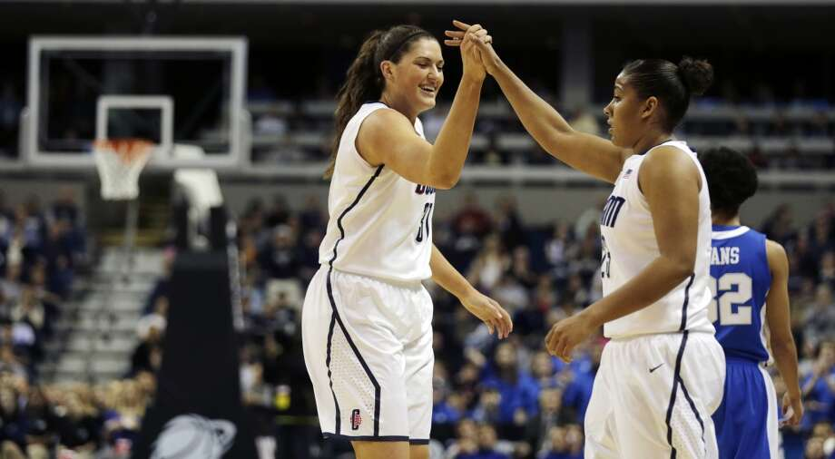 Connecticut center Stefanie Dolson, left, high-fives teammate Kaleena Mosqueda-Lewis, right, in the first half of a women's NCAA regional final basketball game against Kentucky in Bridgeport, Conn., Monday, April 1, 2013. (AP Photo/Charles Krupa)