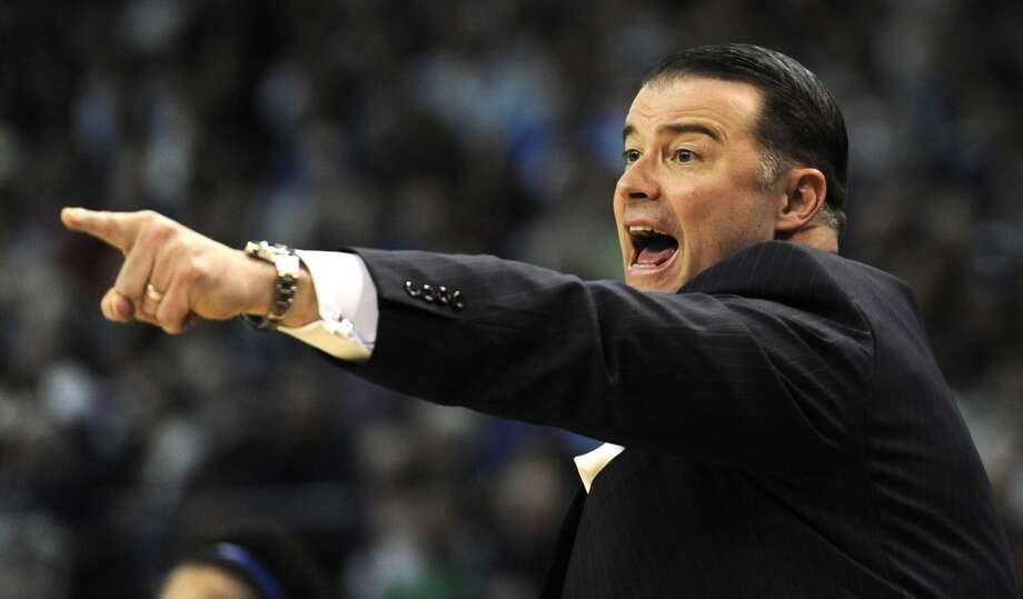 Kentucky head coach Matthew Mitchell calls to his players in the first half of a women's NCAA regional final basketball game against Connecticut6 in Bridgeport, Conn., Monday, April 1, 2013. (AP Photo/Jessica Hill)