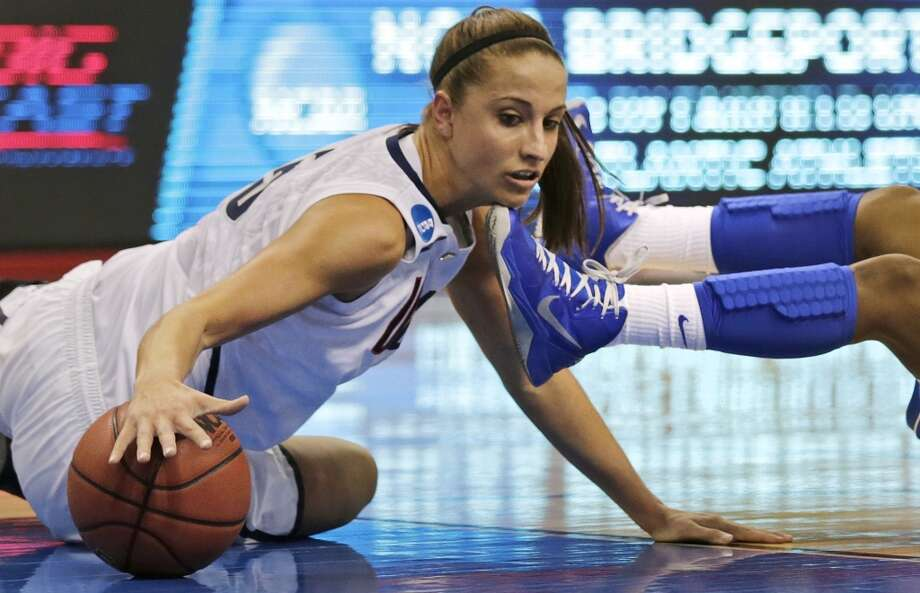 Connecticut guard Caroline Doty, left, tries to regain possession of the ball after colliding with Kentucky guard Janee Thompson, right, in the first half of a women's NCAA regional final basketball game in Bridgeport, Conn., Monday, April 1, 2013. (AP Photo/Charles Krupa)