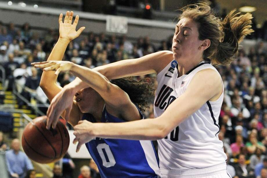 Connecticut forward Breanna Stewart, right, knocks the ball free while battling for a rebound against Kentucky guard Jennifer O'Neill (0) in the first half of a women's NCAA regional final basketball game in Bridgeport, Conn., Monday, April 1, 2013. (AP Photo/Jessica Hill)