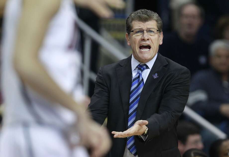 Connecticut head coach Geno Auriemma calls to his players in the first half of a women's NCAA regional final basketball game against Kentucky in Bridgeport, Conn., Monday, April 1, 2013. (AP Photo/Charles Krupa)