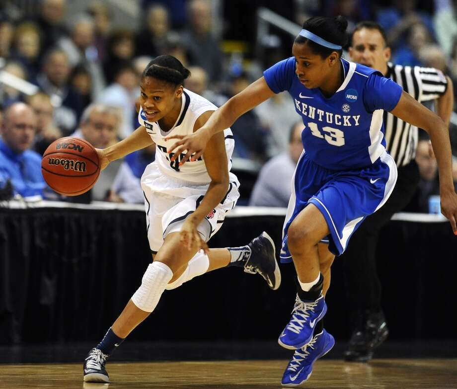 Connecticut guard Moriah Jefferson, left, sprints down court against Kentucky guard Bria Goss (13) in the first half of a women's NCAA regional final basketball game in Bridgeport, Conn., Monday, April 1, 2013. (AP Photo/Jessica Hill)