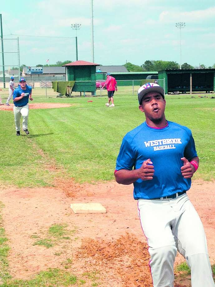 Avi Zaleon/The EnterpriseWest Brook senior Charles Guillory completes a run to first base during practice Monday at West Brook Photo: Avi Zaleon