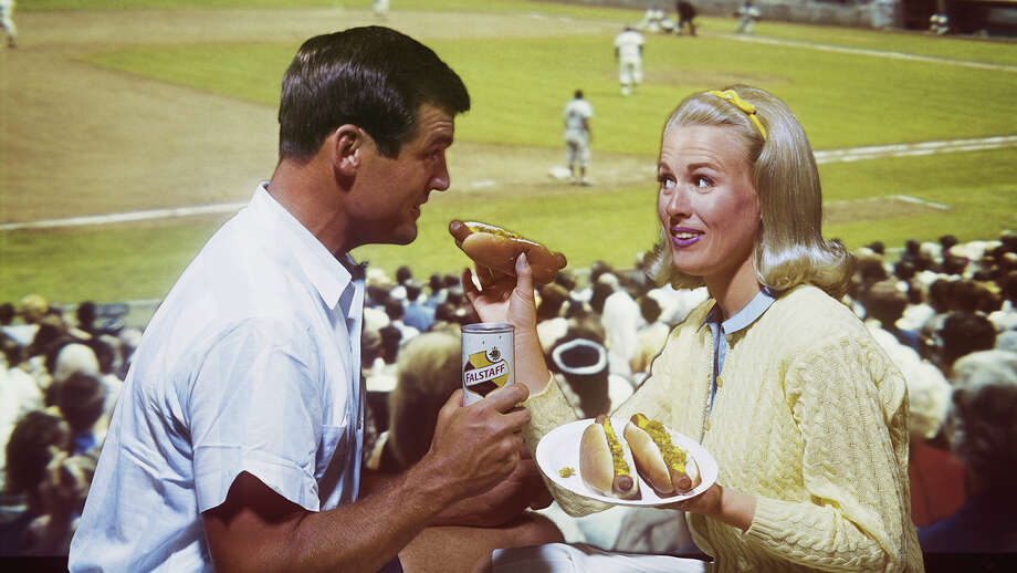 There are exactly zero things more American than a hot dog and a beer at